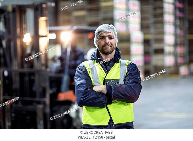 Portrait of confident warehouseman