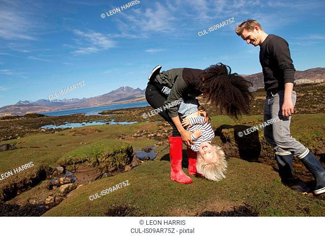 Mother tickling son, Loch Eishort, Isle of Skye, Hebrides, Scotland