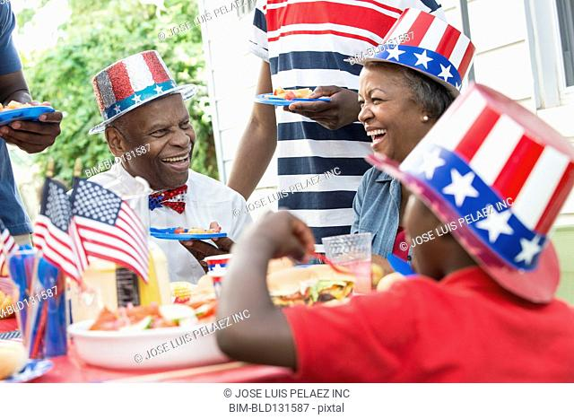Multi-generation family enjoying Fourth of July barbecue