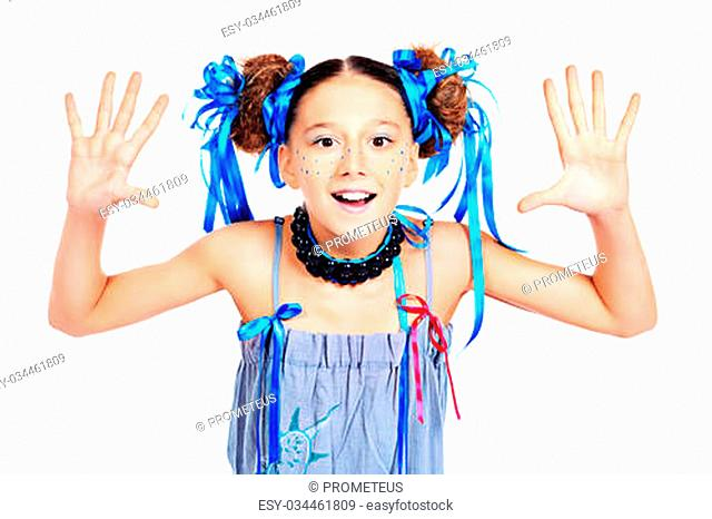 Portrait of a happy funny girl with festive make-up, hairstyle and dress. Isolated over white