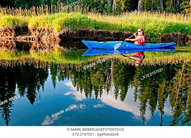 Kayaking on the North Fork of the Payette River near Payette Lake and the city of McCall in the Salmon River Mountains of central Idaho
