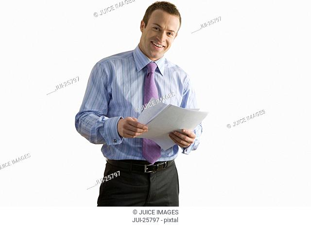 Smiling businessman reviewing report