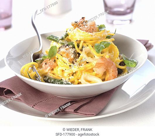 Spaghetti with seafood, basil and Parmesan