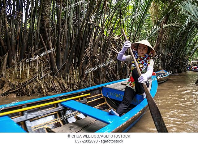 People on Sampan boats on canals on Con Lan (Unicorn) Island, near My Tho, Mekong Delta, Vietnam