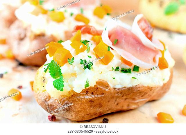 Baked and stuffed potato on the table