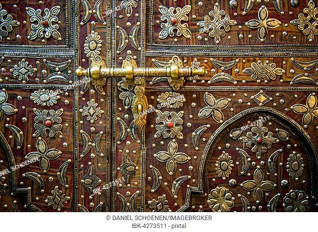 Old artfully decorated door, detail, historic centre, Marrakech, Morocco