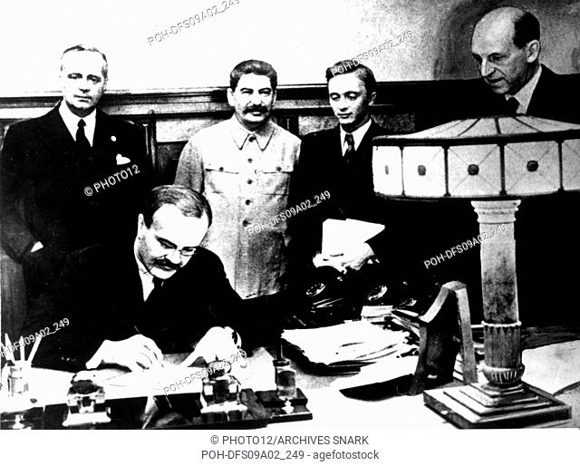 Signing of the Germano-Soviet Non-Agression Pact in Moscow. Molotov signs. Behind him, Ribbentrop and Stalin August 23, 1939 USSR - World War II Washington