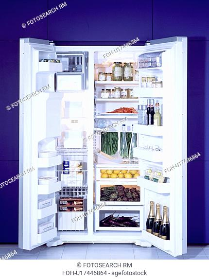 Large American style fridge freezer with doors open showing contents.&13,&10,&13,&10,&13,&10