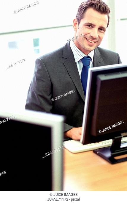 Portrait of a young businessman working in office setting