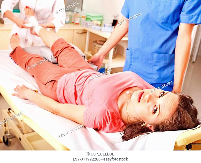 Doctor bandaging patient in hospital