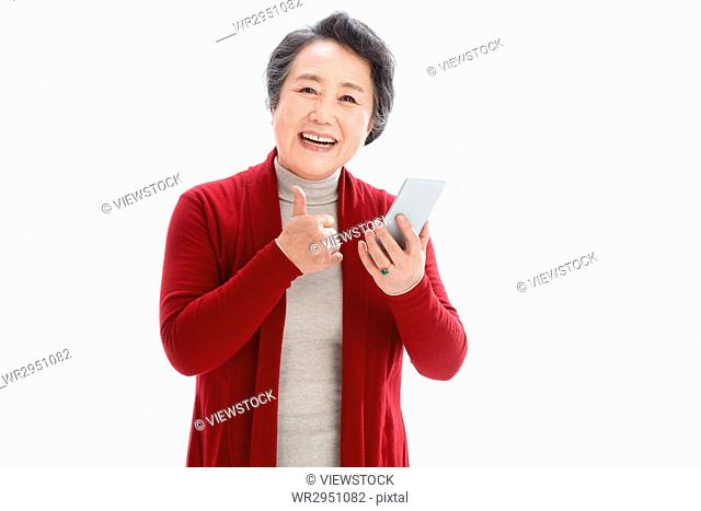 Old woman holding a cell phone