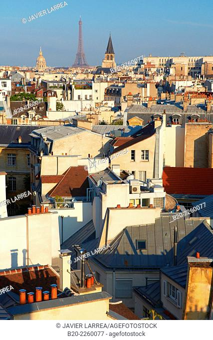 Parisian rooftops. City view. Eiffel Tower, Les Invalides and Saint Germain des Pres church from the Latin Quartier. Paris. France