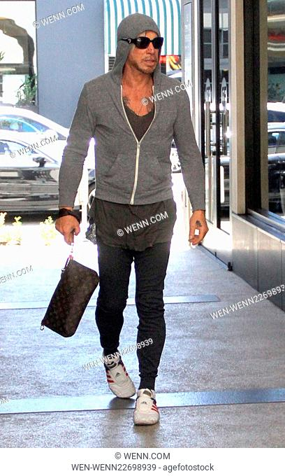 Mickey Rourke goes to Cafe Rome in Beverly Hills in a grey hoodie and patriotic stars and stripes sneakers Featuring: Mickey Rourke Where: Los Angeles