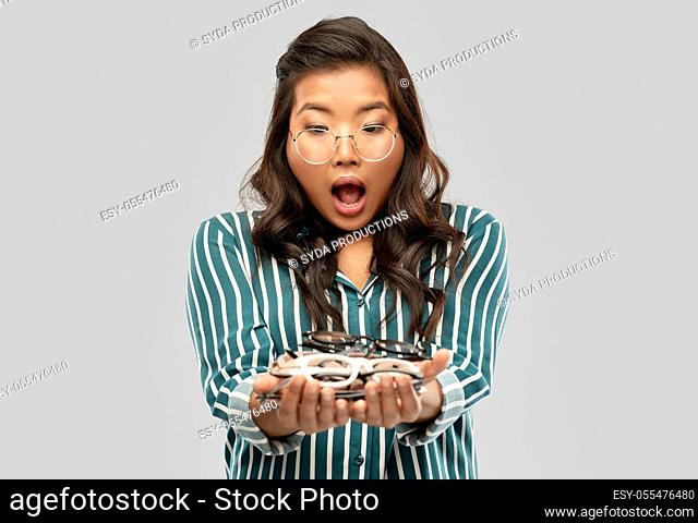 smiling asian woman in glasses or student