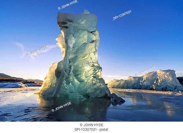 An iceberg glows with the light from the setting sun, Mendenhall Lake, Tongass National Forest; Juneau, Alaska, United States of America