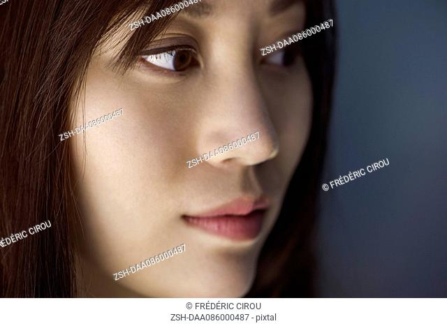Woman looking away, close-up portrait