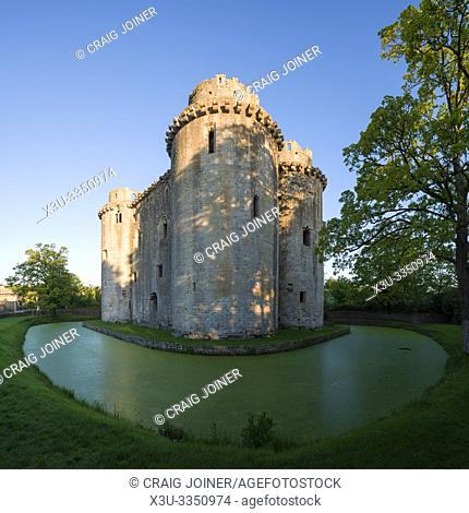 Nunney Castle and moat in the village of Nunney, Somerset, England