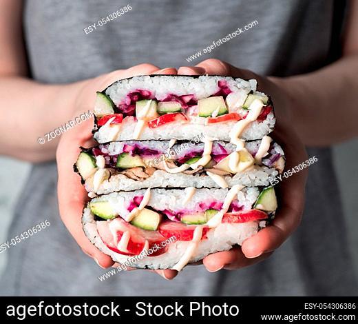 Vegan sushi sandwich onigirazu with mushrooms and vegetables.Healthy dinner recipe and idea. Colorful japan big roll sandwich onigirazu with red cabbage, radish