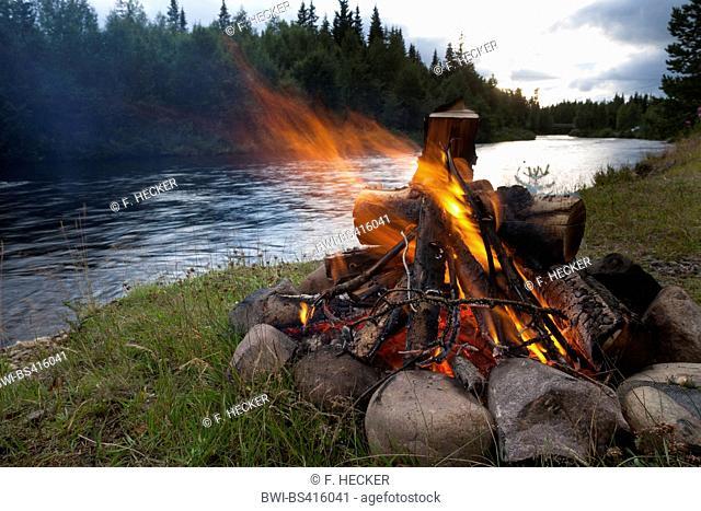 bonfire on riverbank, Sweden