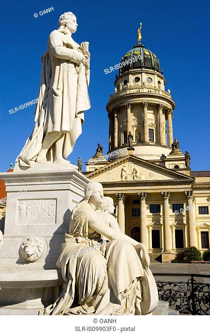 Statue of Fredrich Schiller and French Cathedral in Gendarmenmarkt, Berlin, Germany