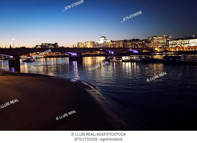 View of the City of London from Lambeth Pier at night, Embankment, River Thames, London, England