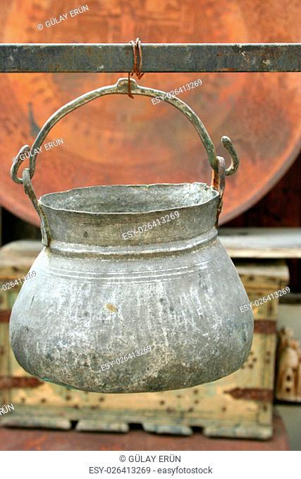 An antique pot hanging on display at a souvenir shop