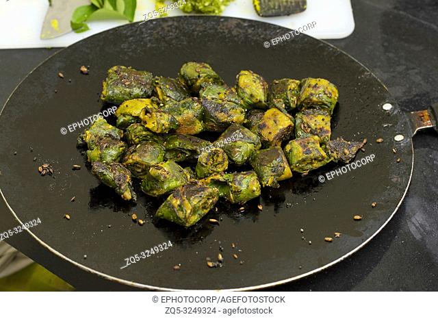 Alu Vadi or Colocasia leaves steamed and then fried. Maharashtrian and Gujrati snack
