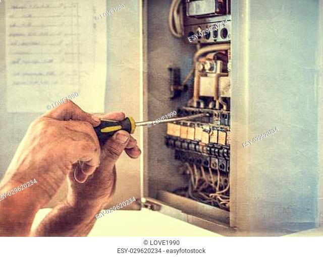 Electrician works on equipment, retro styled photo