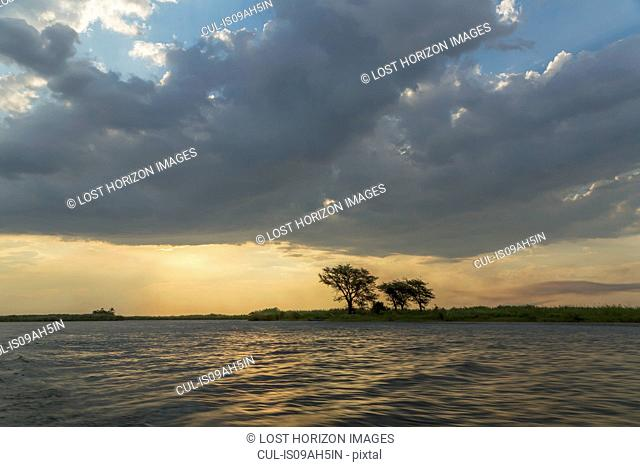 Water and silhouetted trees, Kasane, Chobe National Park, Botswana, Africa