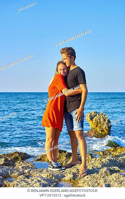 Bonding young Dutch couple enjoying togetherness outdoors at seaside in the holiday destination Hersonissos, Crete, Greece