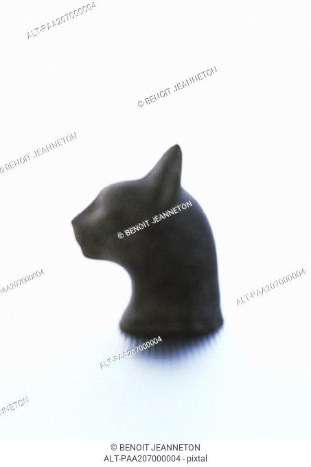 Cat head statuette, blurred