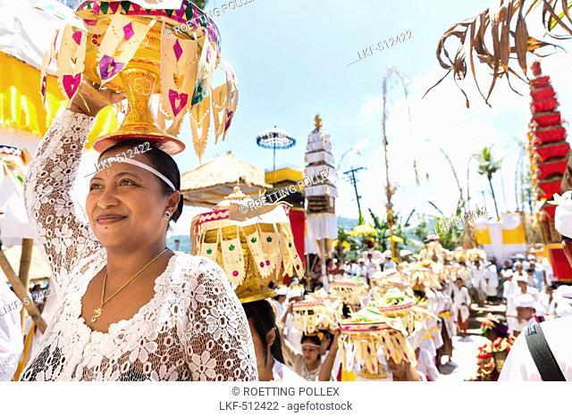 Women carrying offerings on their heads, Odalan temple festival, Sidemen, Karangasem, Bali, Indonesia
