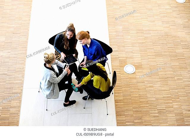 Colleagues having meeting using digital tablet