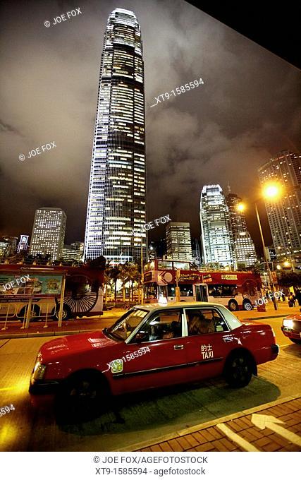 hong kong red taxi at taxi rank at night in front of international finance centre 2 on hong kong island, hksar, china