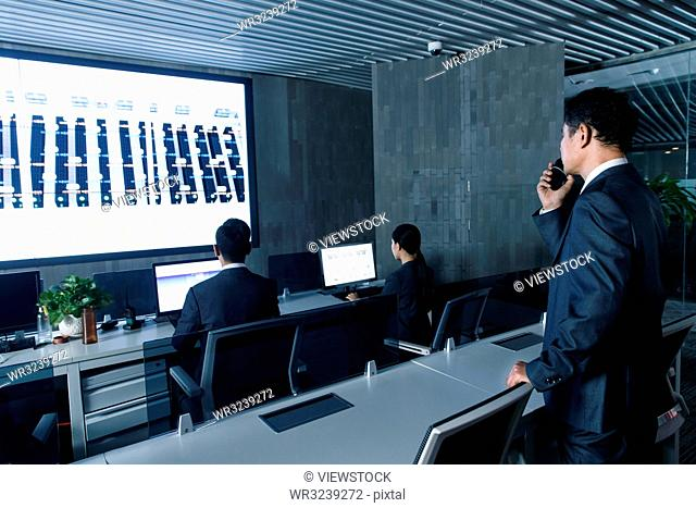 Business people in the control room