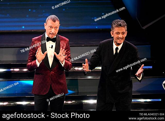 Sanremo Festival host and artistic director, Amadeus, and Italian showman Rosario Fiorello (R) on stage at the Ariston theater during the 71st Sanremo Italian...