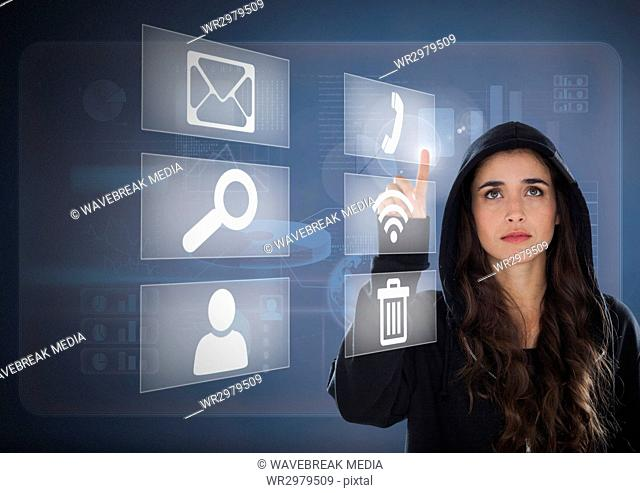 Woman hacker touching digital icons on screen with her finger