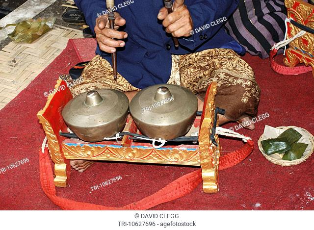 The gamelan a brass percussion instrument mounted in ornate carved and painted frame and widely used throughout Indonesia Bali Indonesia