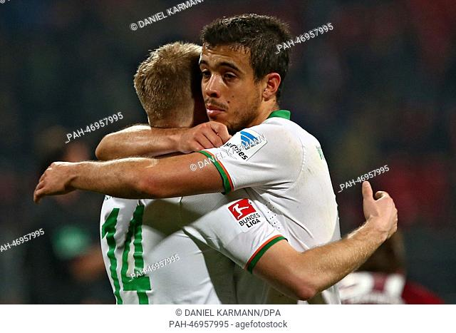 Bremen's Franco Di Santo (R) celebrates with his colleague Aaron Hunt after the German Bundesliga soccer match between 1