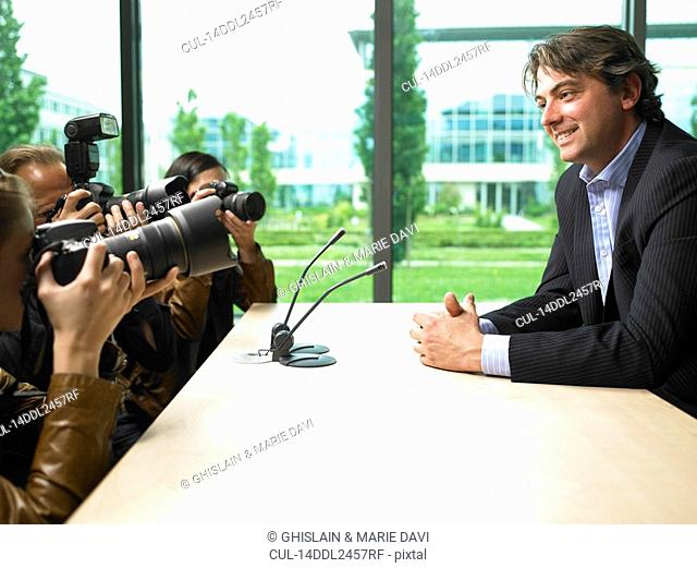 Business man giving a conference