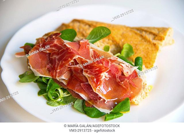Iberian ham with water cress and olive oil on slied bread. Spain