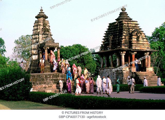 India: A group of Hindu pilgrims visiting the temples of Khajuraho's western complex, Khajuraho, Madhya Pradesh State