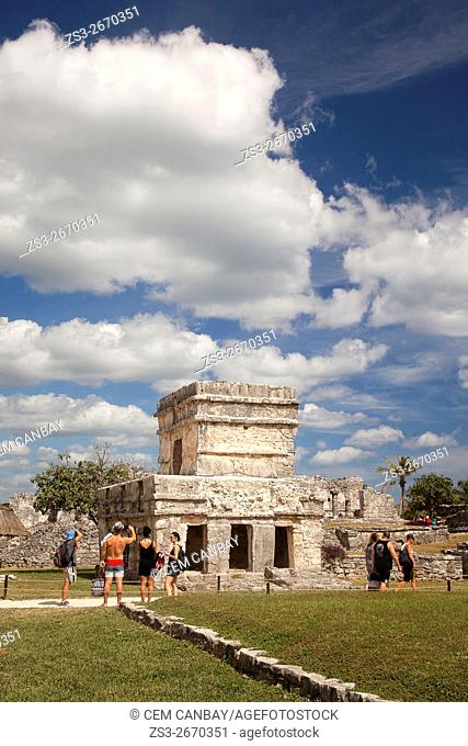Tourists in Mayan Ruins at Maya archeological site of Tulum near the Castle-Castillo, Quintana Roo, Yucatan Province, Mexico, Central America