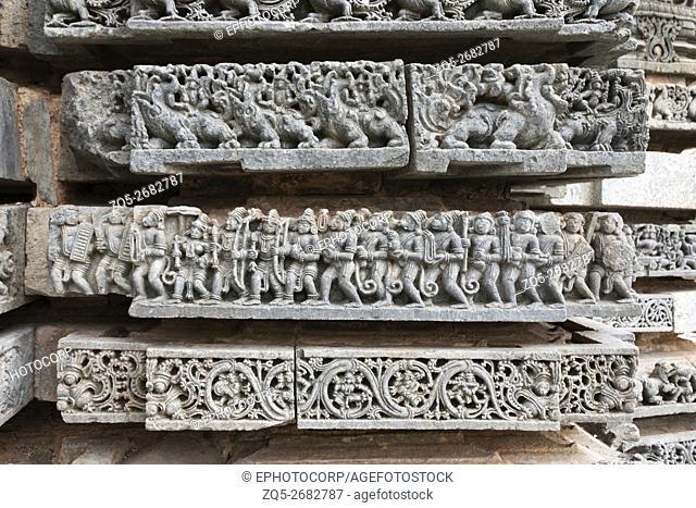Episode from Ramayana. Rama, Sita and Laxmana returning from Lanka. Kedareshwara temple, Halebidu, Karnataka, india