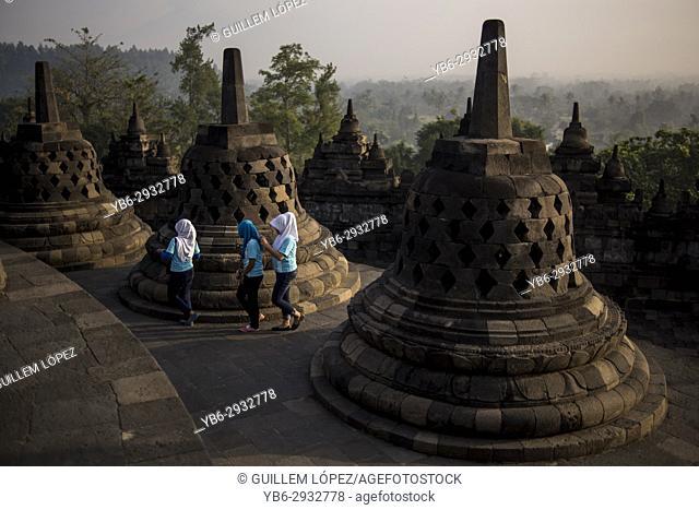 Muslim local tourists at the Borobudur Temple in Java, Indonesia