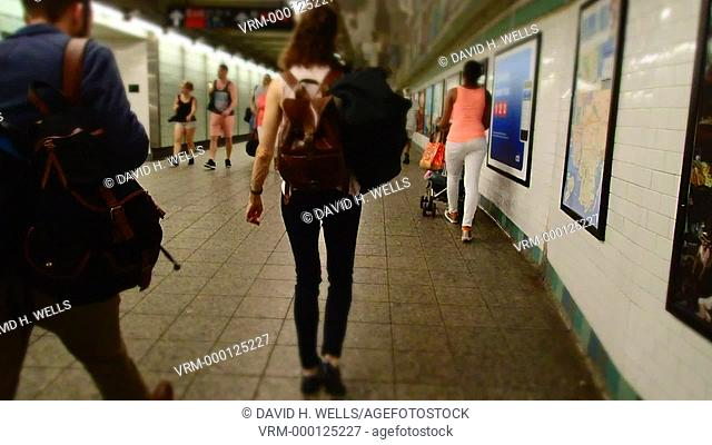 Pedestrians walking in the subways in New York, New York, distorted with an art filter and time-lapse imaging