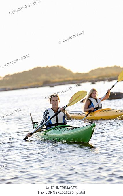 Mother with daughter kayaking