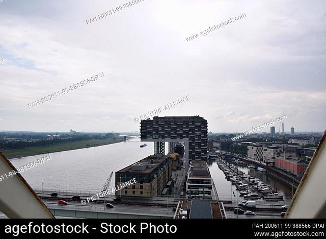 10 June 2020, North Rhine-Westphalia, Cologne: View of the Rhine, Rheinauhafen and Kranhaus. Photo: Horst Galuschka/dpa. - Cologne/North...