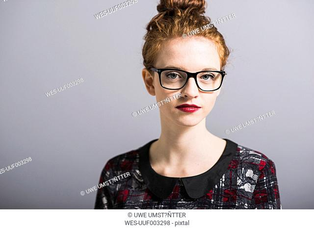 Portrait of confident young woman with glasses