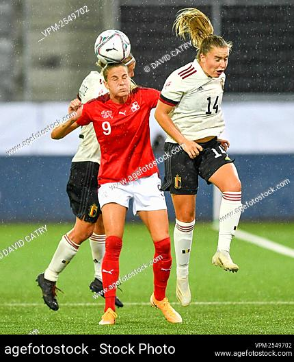 Switzerland's Ana-Maria Crnogorcevic and Belgium's Davinia Vanmechelen fight for the ball during a soccer game between Switzerland and Belgium's Red Flames